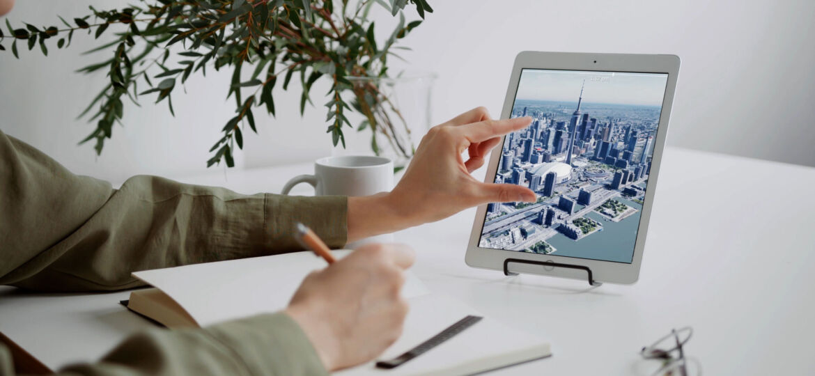 A person uses the 3D CityScapes app on a tablet.